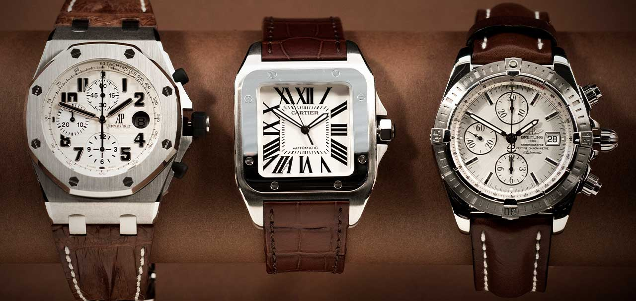 Collection of three luxury watches on display