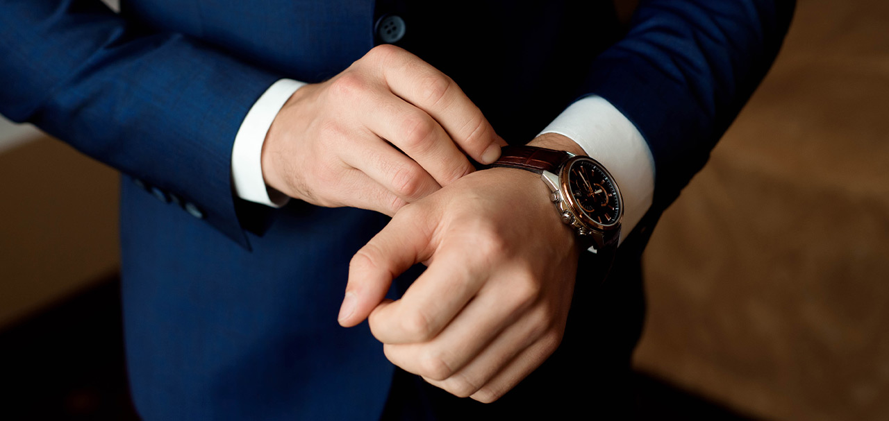 Man in suit putting on Graham watch