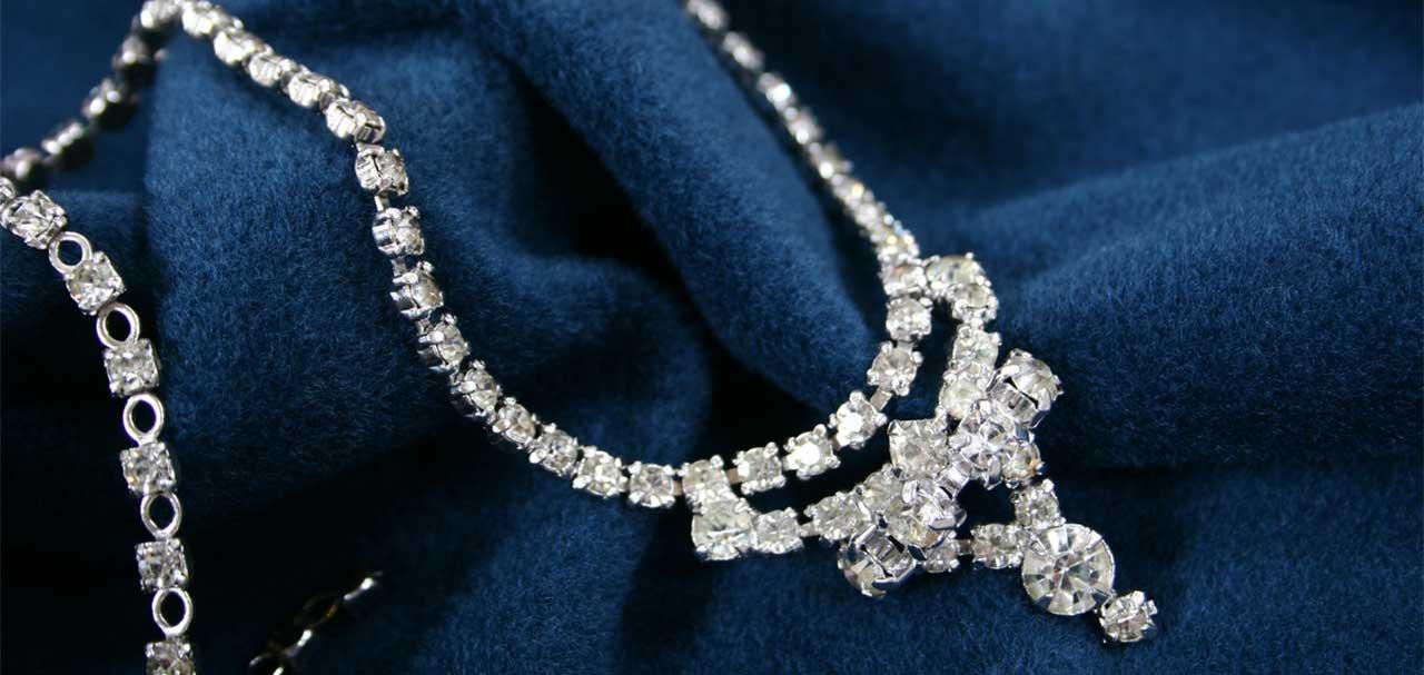 Luxury diamond necklace on blue fabric